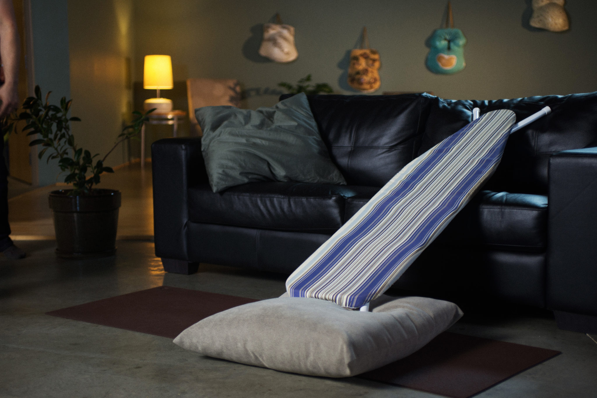 Secure a board or ironing board with pillows and lean it on the couch for the angle best to back s breech baby out of the pelvis and help baby flex the head as baby is directed onto the inner fundus of the uterus.
