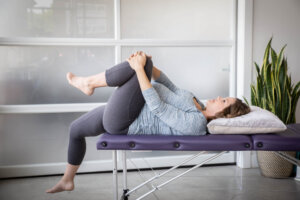 woman does psoas release off of a massage table