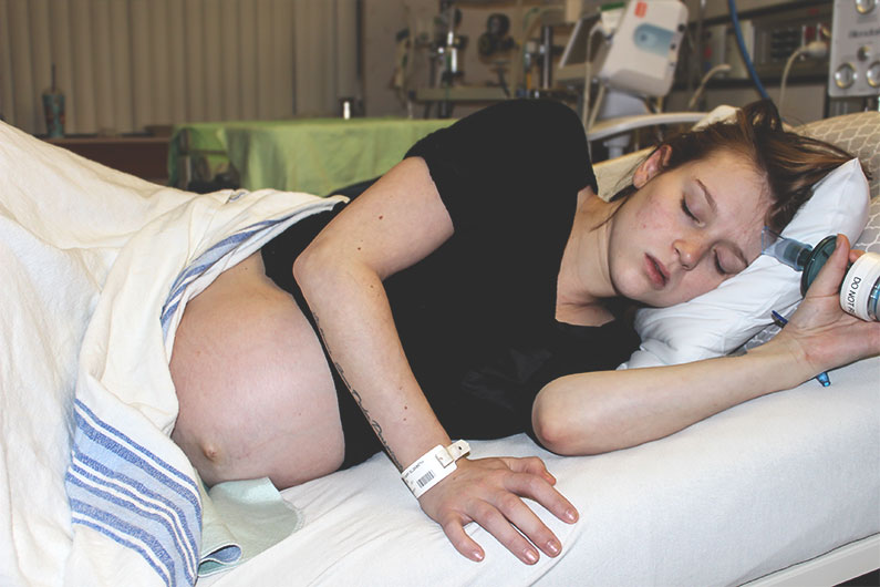 woman in labor laying on side